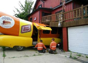 An Oscar Mayer Wienermobile crashed into the home and outdoor deck of Nick Krupp, 1200 Kenilworth Ave., around 11 a.m. Friday, July 17, 2009. According to a witness, the vehicle was parked in the driveway. The driver lurched the vehicle forward instead of backing out of the driveway, hitting Krupp's deck and cracking the foundation of his house.