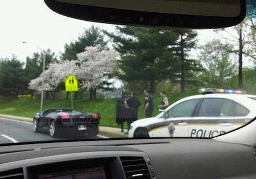 Batman was pulled over for speeding.
