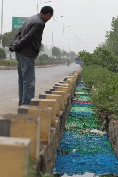 Mysterious Rainbow River of Pills Appears In China (1/6)